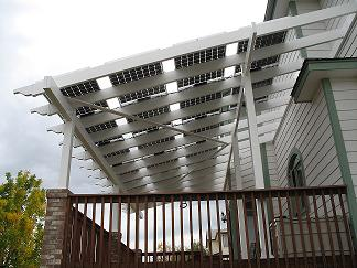 Solar electric panels on a shade producing pergola